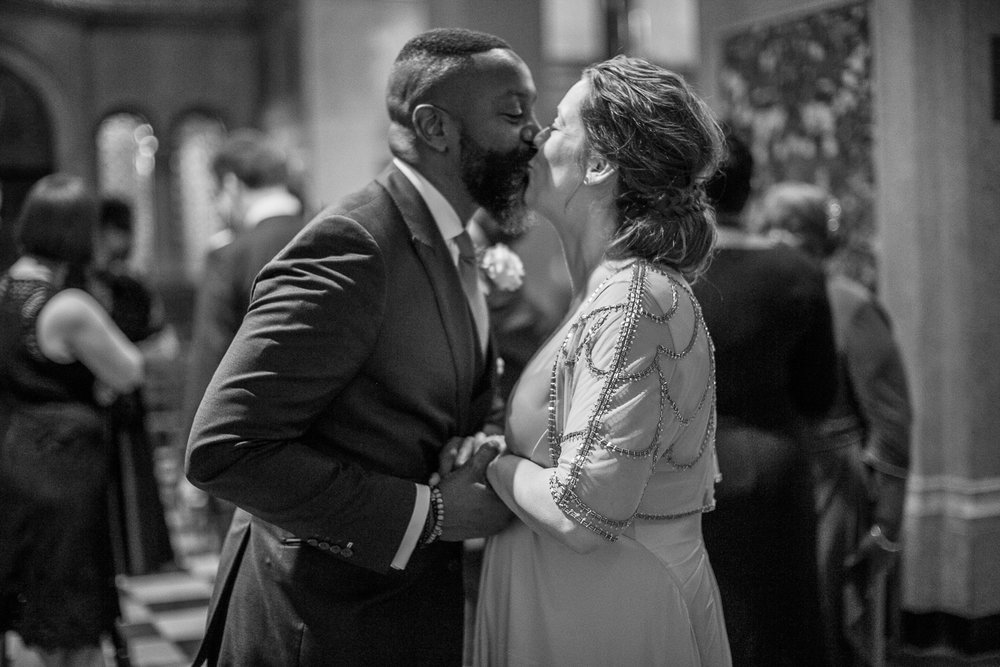 Black and white portrait of a bride and groomkissing at their intimate restaurant wedding in New York City. | Upper West Side Intimate Wedding | Kate & Sylvester's wedding in Manhattan.