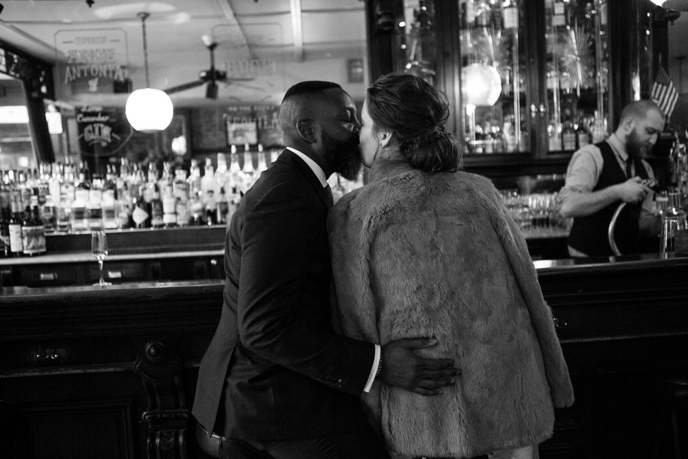 Black and white portrait of a couple kissing at their intimate restaurant wedding venue in Manhattan. | Upper West Side Intimate Wedding | Kate & Sylvester's wedding in Manhattan.