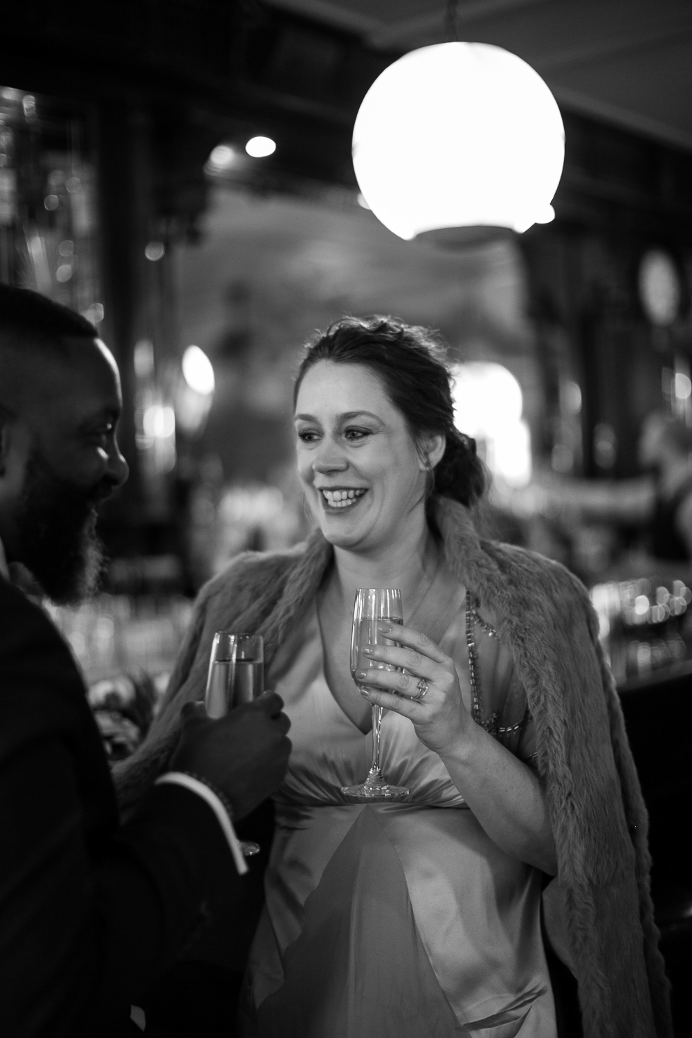 Bride toasting the groom with champagne at their intimate restaurant wedding venue in Manhattan. | Upper West Side Intimate Wedding | Kate & Sylvester's wedding in Manhattan.