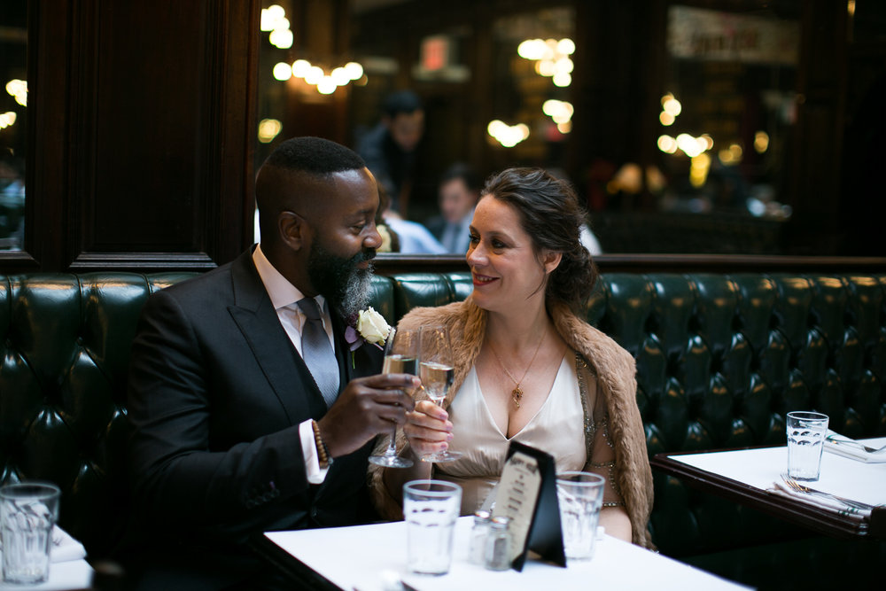 Bride and groom toasting with champagne at their Upper West Side Wedding Venue. | Upper West Side Intimate Wedding | Kate & Sylvester's wedding in Manhattan.