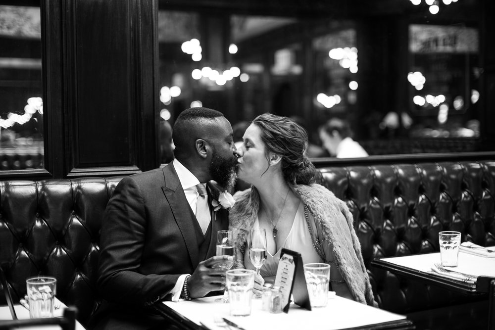 Bride and groom kissing at their intimate restaurant wedding in Manhattan. | Upper West Side Intimate Wedding | Kate & Sylvester's wedding in Manhattan.
