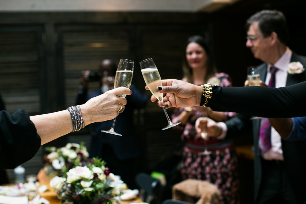 Toasting the bride and groom at their Upper West Side Wedding Venue. | Upper West Side Intimate Wedding | Kate & Sylvester's wedding in Manhattan.