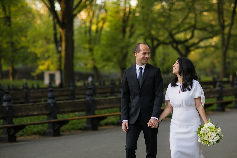 Bride and groom taking wedding photos at the mall in Central Park. | Early Morning Sunrise Central Park Elopement in New York City.
