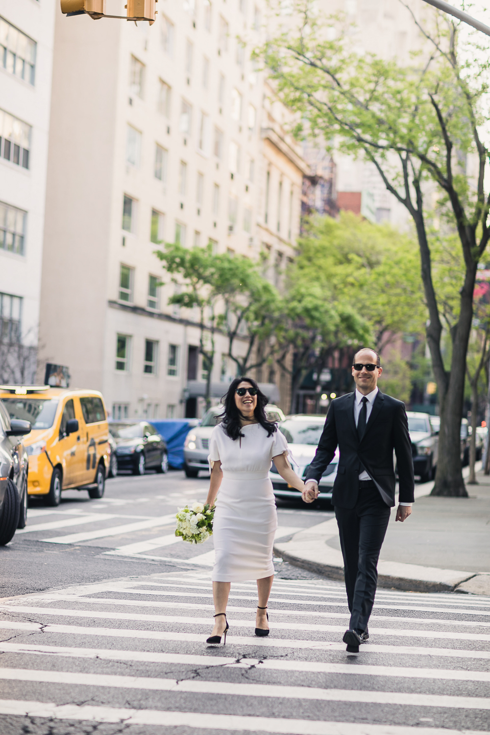 Bride and groom taking wedding photos in Central Park. | Early Morning Sunrise Central Park Elopement in New York City.