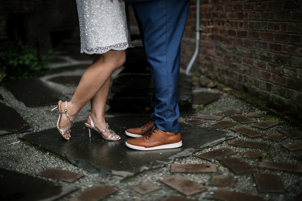 Close up wedding portraits of bride wearing jeweled sandals and groom wearing brown shoes | Intimate Wedding at the Malthouse in Manhattan, New York City.