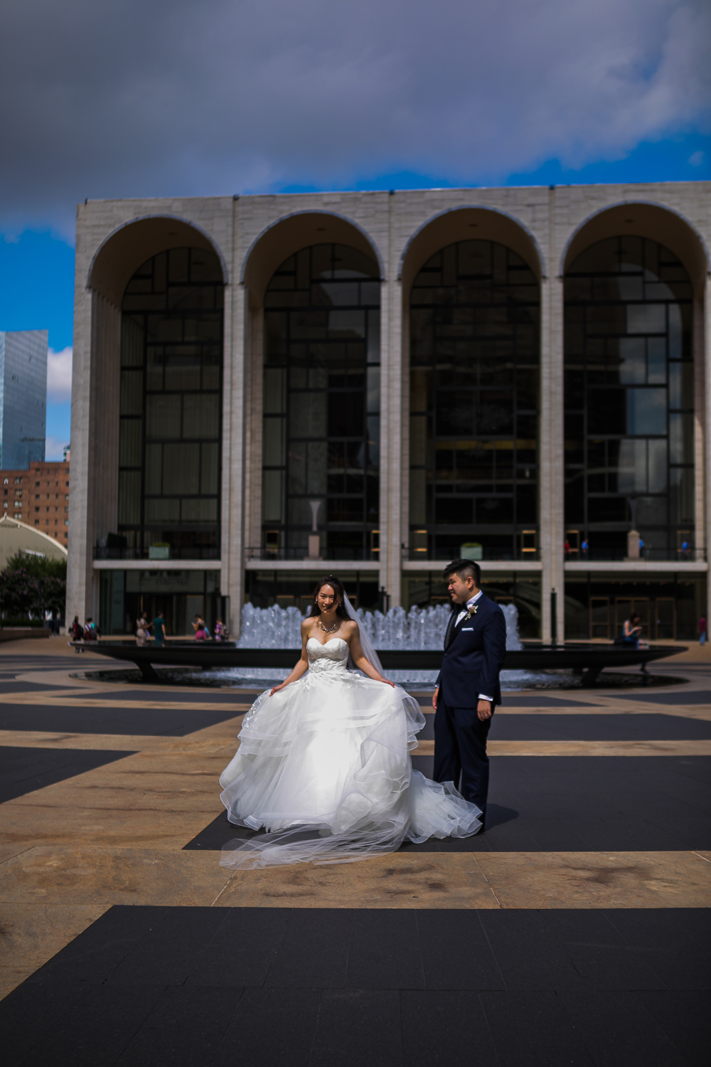 Portrait of a couple posing for wedding portraits at Lincoln Center in New York City   Lincoln Center Wedding Photos   Jason and Susanna's Glam NYC Elopement