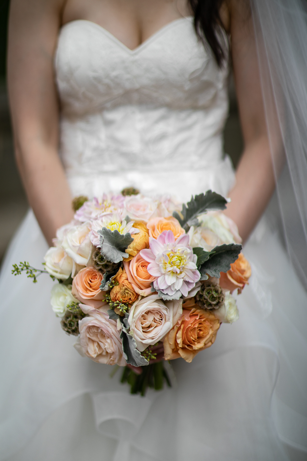 Close up portrait of a bride's white, pink, and peach wedding bouquet.   Lincoln Center Wedding Photos   Jason and Susanna's Glam NYC Elopement