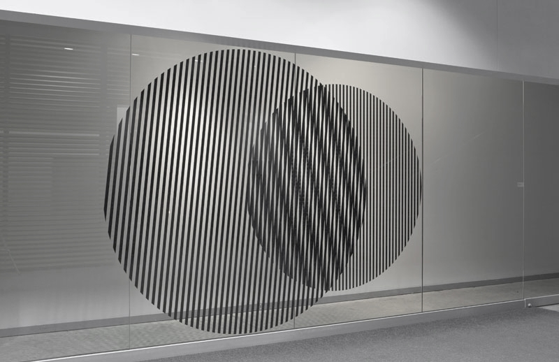 Untitled (where we're at)  2011, Vinyl strips on the wall and window of a vitrine, each circle 6ft in diameter