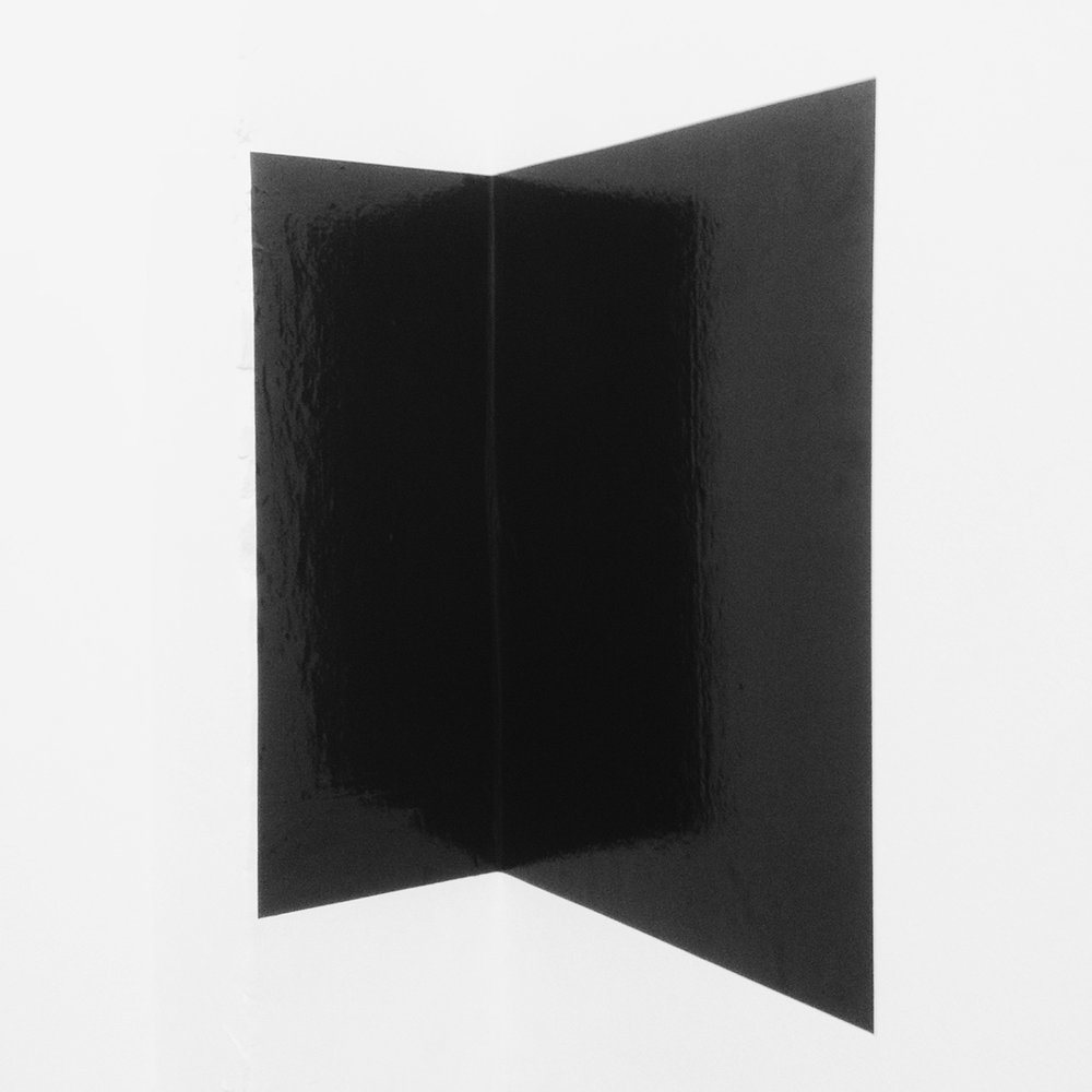Untitled (introspection)  2014, Temporary site specific installation, black glossy vinyl adhered to a corner, approx 36 inches high