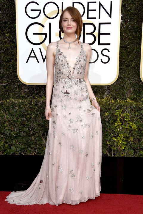 Emma Stone in a Valentino Haute Couture Dress and Tiffany & Co. jewelry