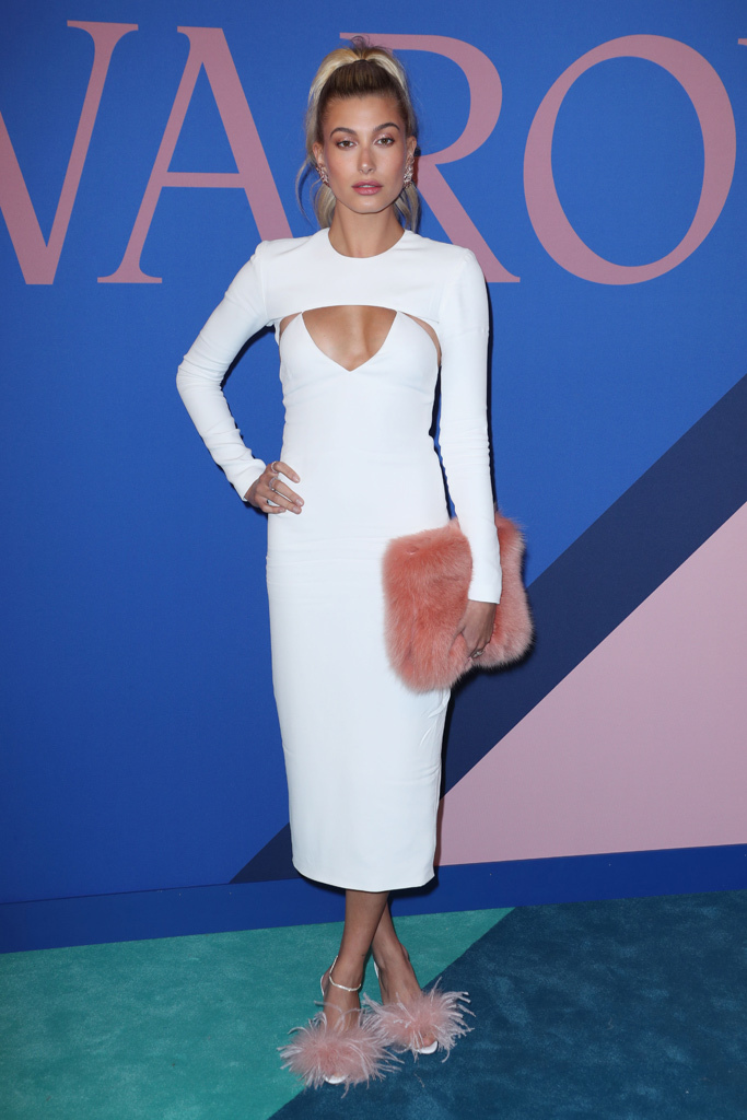Hailey Baldwin  - This outfit is one of my favs because it is just a simple white dress. The pink and furry accessories makes this simple dress a fun and unique outfit.