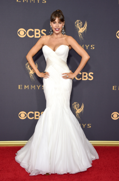 Sofia Vergara brought her A-game this weekend, serving us some wedding looks on the red carpet. Looking white hot from head to toe, she matched her chandelier earrings to her white gown (by Mark Zunino). Click the link below to see our favorite chandelier earrings for this season.