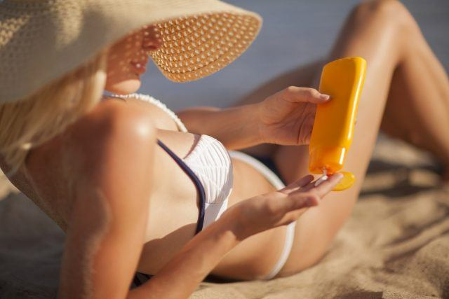 Woman-with-suntan-lotion-640x427.jpg
