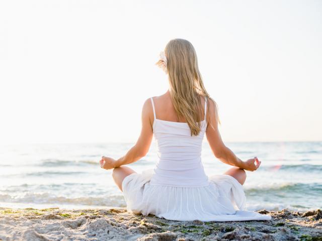 girl_meditating_on_the_beach__medium_4x3.jpg