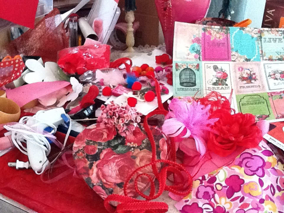 "My mom's handmade Galentine's decorations, in process. Her official caption: ""pink and red explosion."""