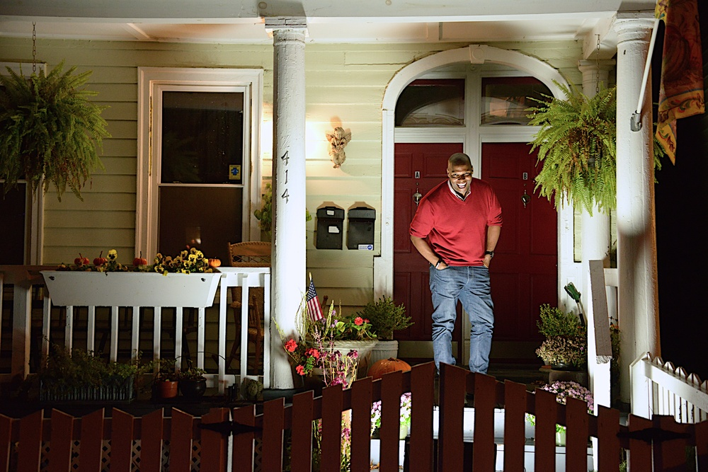 Photographed on the front porch of the first home he has owned located on historic Church Hill.