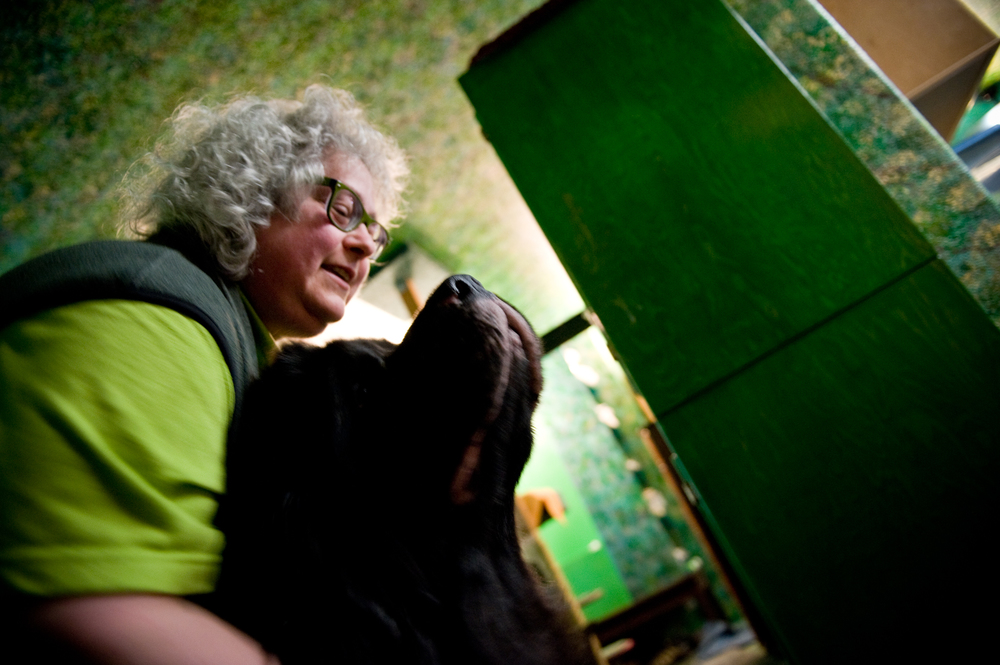 "Leska Emerald Adams, 51, lives with friend Lynn Szender and her service dog, Orka. Diagnosed with autism in fourth grade, Leska says, ""I knew I was different but I didn't know why or I had no idea HOW different I was.  I just knew that everything I wanted socially...to talk to other little kids and play with them, it never happened.  It did not happen.""  Her symptoms remained mostly manageable until divorce led to an autism regression and subsequent Asperger's diagnosis almost 40 years later."