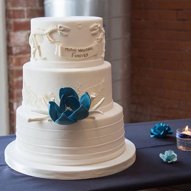 "This is probably the most awesome cake that I've ever shot. The goal - ""classy dinosaurs"" @milkglasscakes did an amazing job, seriously... They are my new favorite ever. #classydinosaur #mutualweirdnessforever #clevelandwedding #urbanwedding #brewery #brewerywedding #offbeatbride #alternativeweddingphotographer #notyourmommasweddingpictures #greatlakesbrewing #offbeatweddingphotographer #lovewhatido"