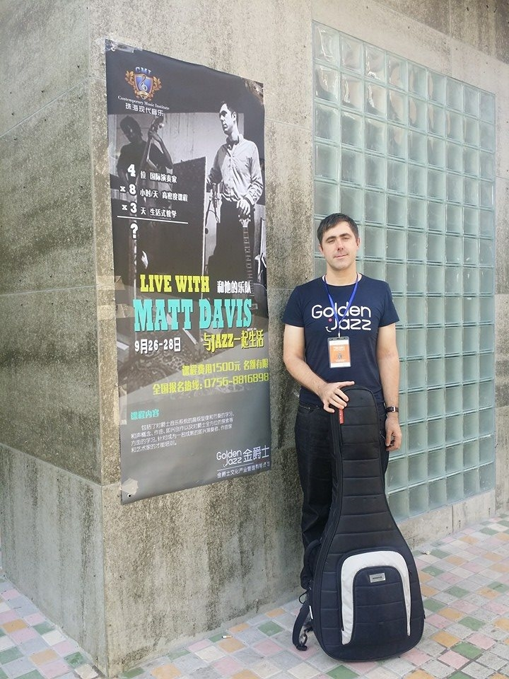 Me in front of CMI with poster.jpg