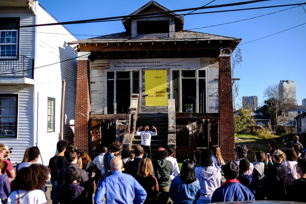 "Photography by Scott McCrossen/FIVE65 Design  In December 2014, Blights Out activated Home Court Crawl with a porch crawl/roving performance in collaboration with Junebug Productions. Artists ""performed architecture"" by engaging in a call-and-response with blighted homes, reading the architecture as text, riffing on the absurd state of the hollow structures, and energizing them with folly, rage, spirit, and joy. The performance was carried from house to house by a second line with music and food."