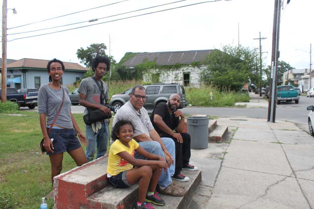 "Photography by H. Hickman  In May 2015, local artists Katrina Andry, Ron Bechet, Amy Bryant, Jer'Lisa Devezin, Keith Duncan, Horton Humble, and Varion Laurent engaged in a ""Live Action Painting"" of portraits of blighted houses. This quiet event unfurled without PR attention—it was a humble opportunity for artists to engage in dialogue with residents and meditate on the sensory experience of blight. The event took place soon after the City of New Orleans placed several hundred blighted properties up for auction; housing rights advocates and neighbors alike feared that the auction would lead to a land grab and bloodletting of rapidly gentrifying neighborhoods like New Orleans' historic 6th Ward. Residents reported non-local white folks ""swarming"" the neighborhood with cameras. Blights Out was interested in carefully navigating the delicate situation, strategically bringing only local Black artists to paint plein air and engage in candid conversation about the changing neighborhood. The decision to invite only Black artists was controversial amongst our participants and generated a meaningful discussion about race relations, gentrification, and public perception."