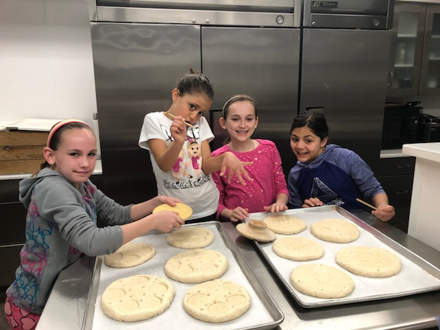 Our young bakers peparing the Prosfora