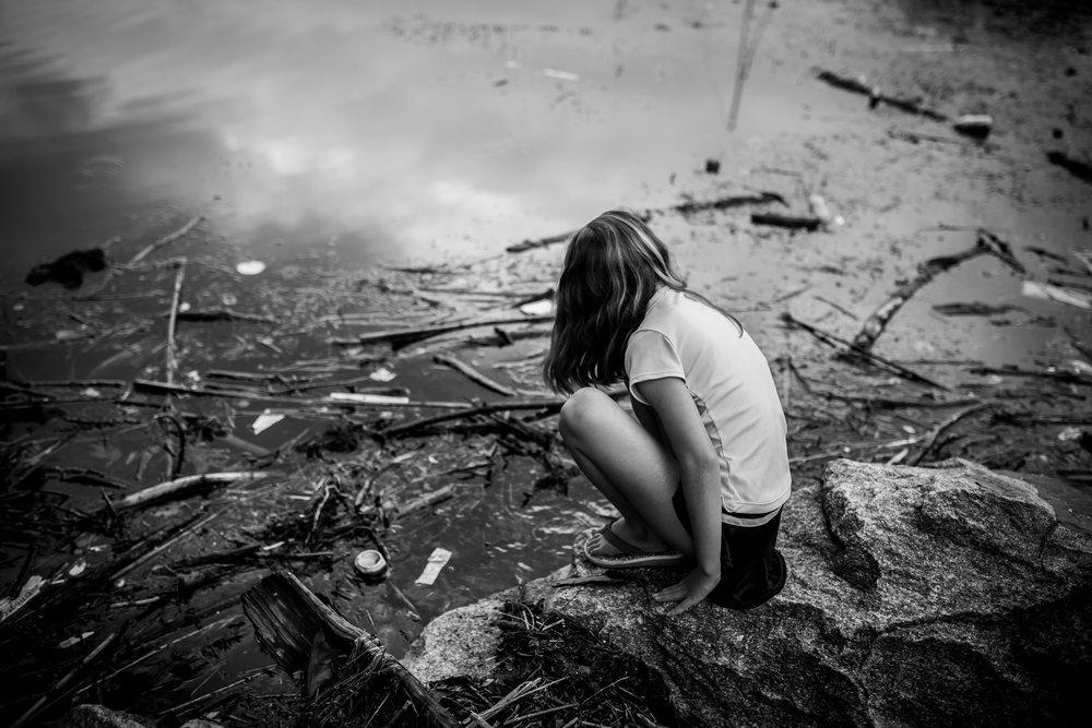 girl by riverbank