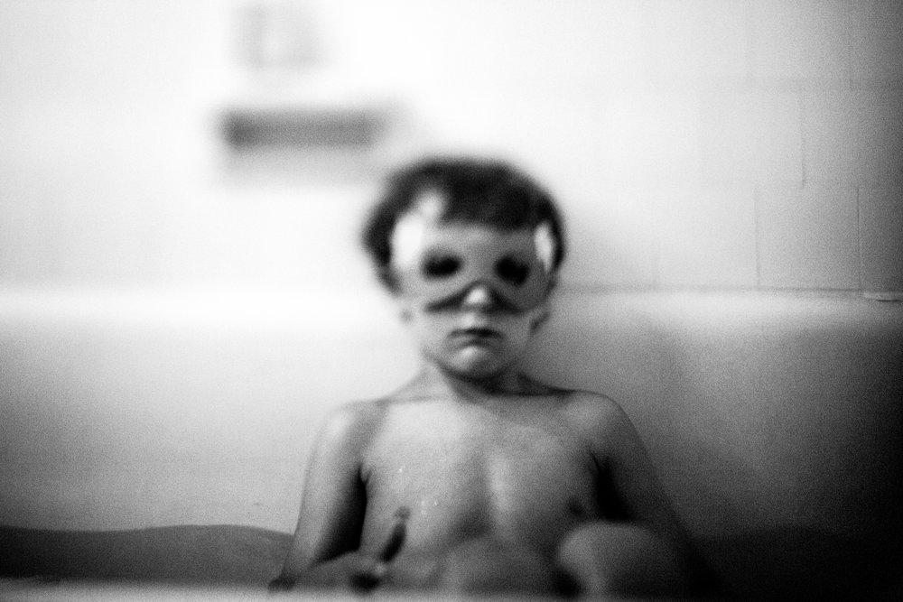 boy in superhero mask