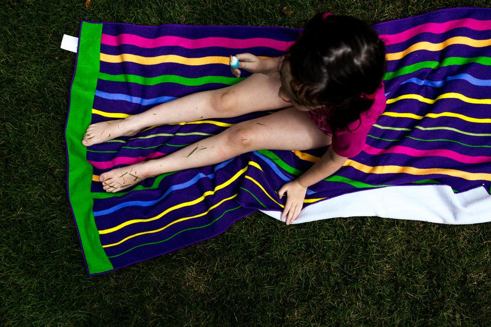 Child on a beach towel