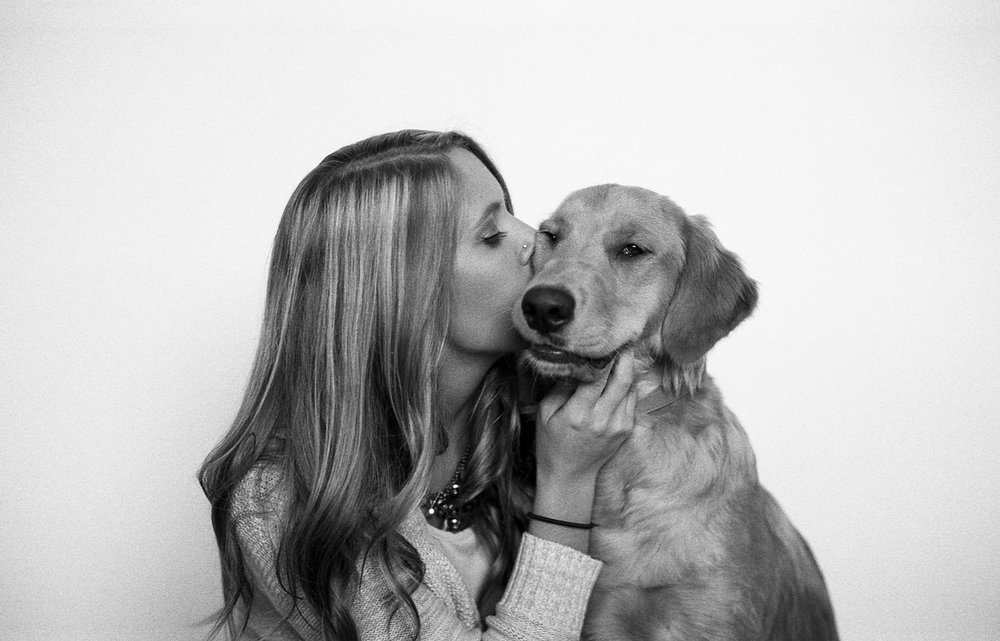 Portrait of a young woman and her Golden Retriever.