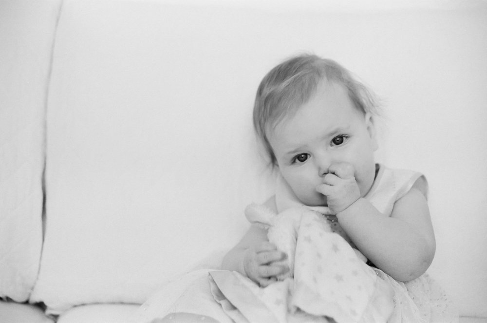 Nine month milestone portrait on film of a little girl.