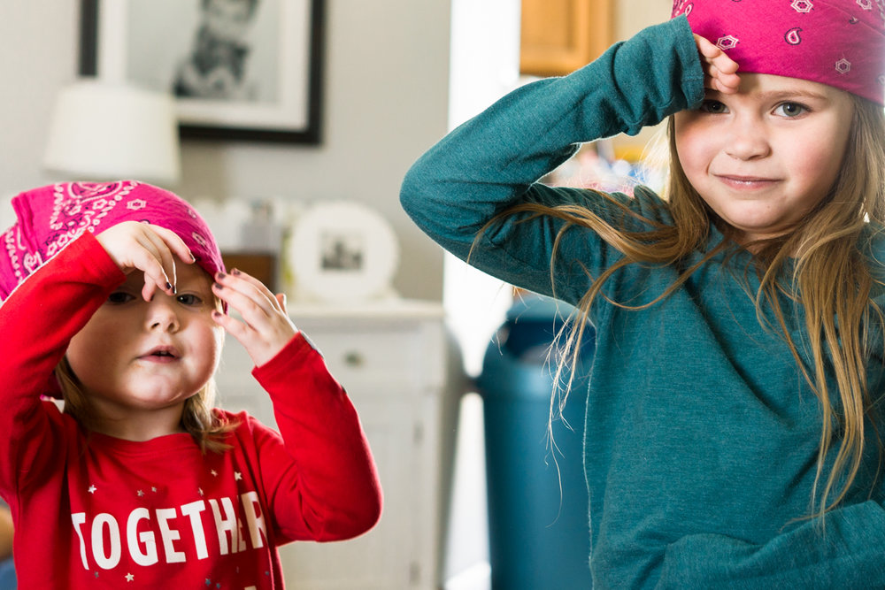 Two little girls playing pirate and making pirate gestures during play in West Fargo daycare.