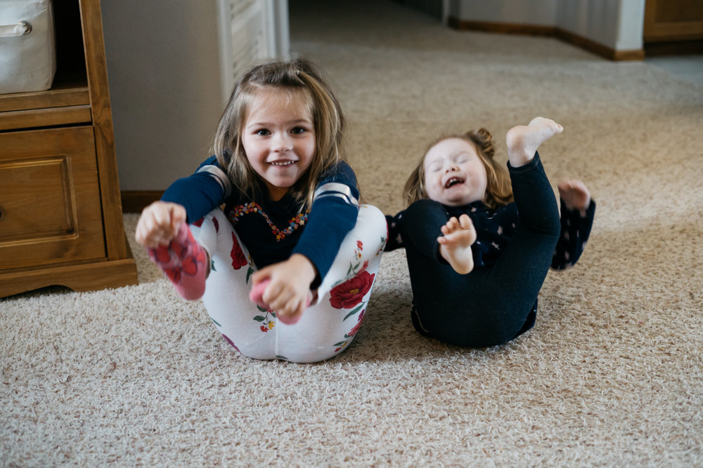Gross motor activity with two small girls at daycare in West Fargo.