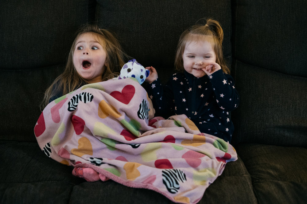 Two little girls cuddling their lovies at daycare in West Fargo.