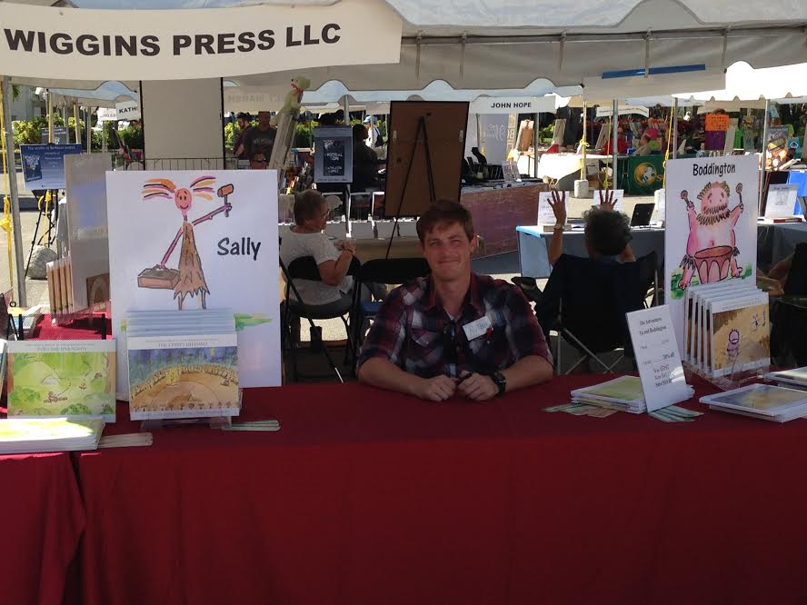 Author James Zwerneman displays his books at the Tampa Bay Times Festival of Reading in Tampa, FL.