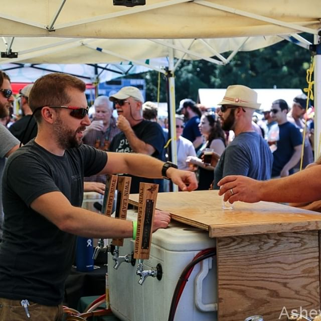 Rare sighting of Twin Leaf Brewery's Owner, Tim Weber, pouring beer instead of brewing beer (or drinking it!) You can catch @twinleafbeer along with some of your other favorite South Slope staples at this year's festival. #drinklocal #supportlocal #avlbeer #southslopeasheville #brewgrass2018