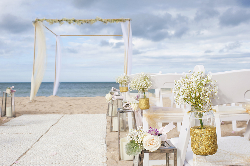 Love Structure, Pebble matting, Lanterns, Gladiator Chairs & Glitter Jars