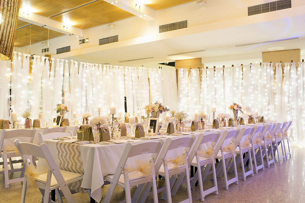 Gladiator Chairs with Gold Sashes & Tulle & Fairy Light Divider