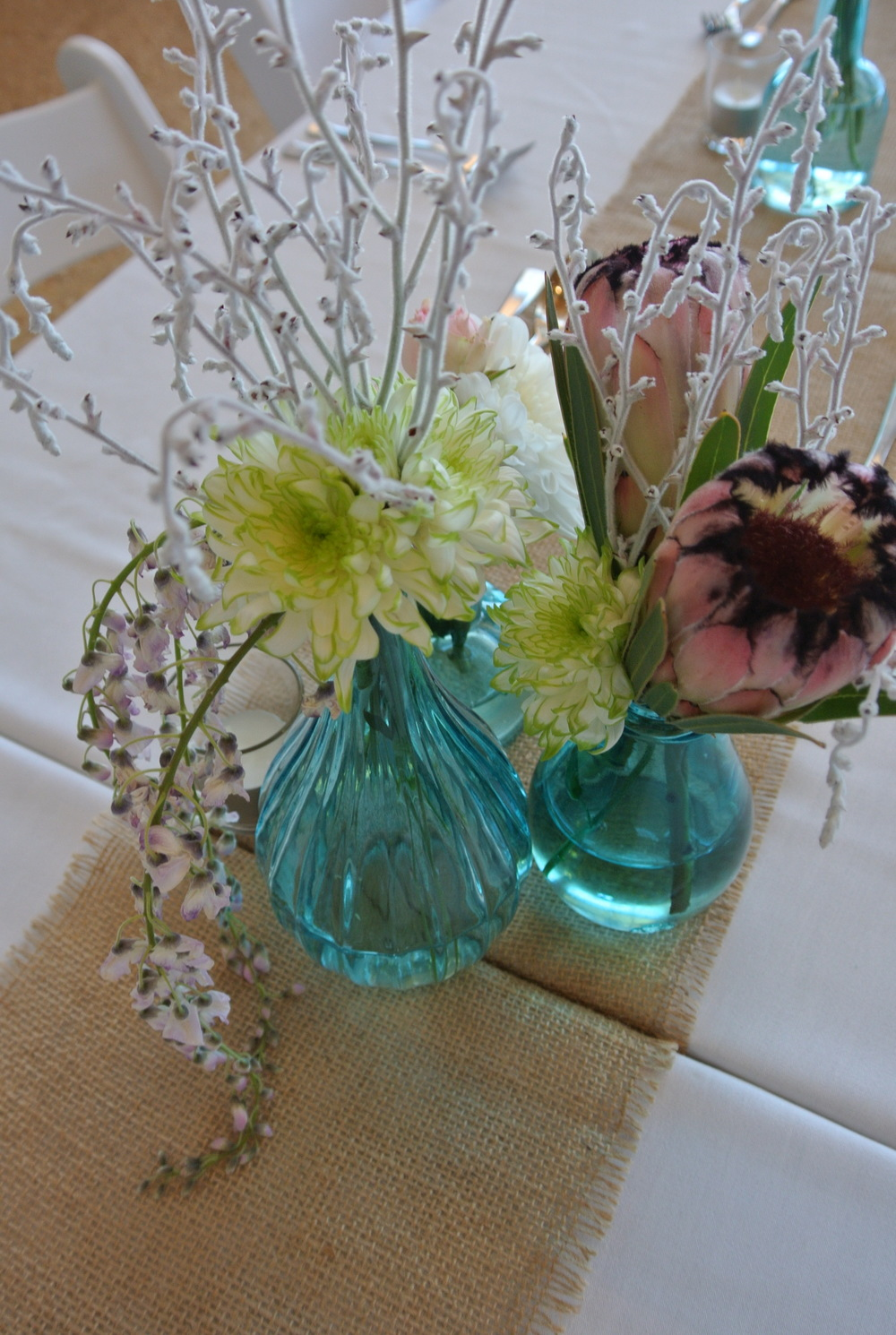Blue Vases Including Arrangements by Salt & Sand