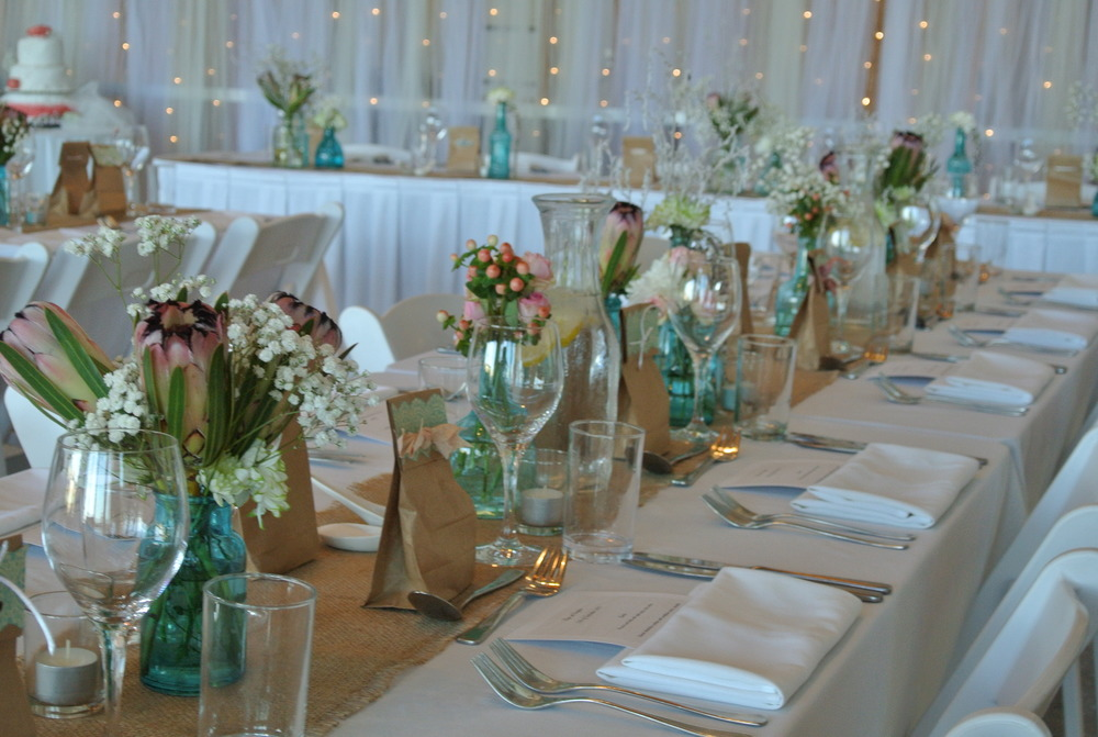 Hessian Runners & Various Blue Vases Including Arrangements by Salt & Sand