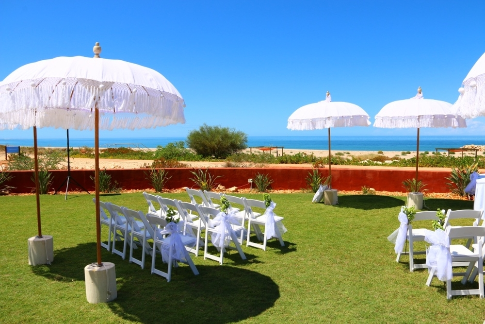 Ceremony Setup Including Bohemian Umbrellas & Gladiator Chairs