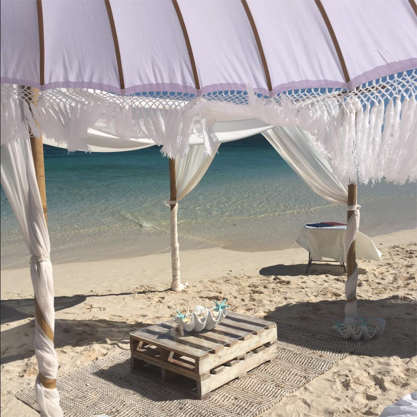 Bamboo Structure & Pallet Table & Rug Image Courtesy: Hilary Van Eldik Marriage Celebrant