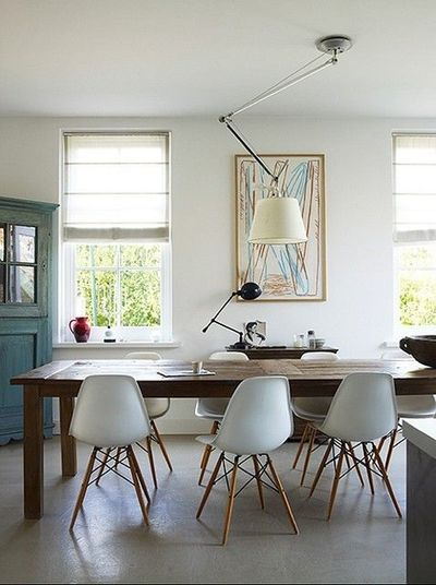 design classic lighting farm house with huge dining table surrounded by chairs designed charles and ray eames the image below also shows classic lighting artemide what can modern classics do for your interior content