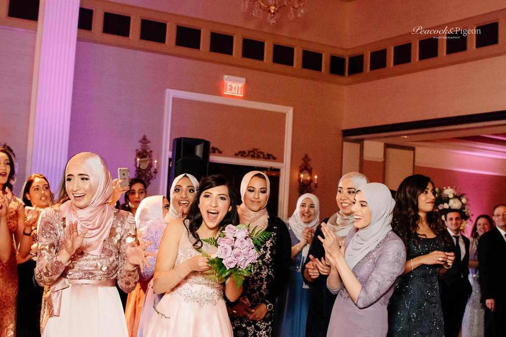 The_Wedding_of_Radwa_and_Kareem_at_Somerset_Palace_Part_Seventeen_Throwing_the_Bouquet_Watermarked-29.jpg