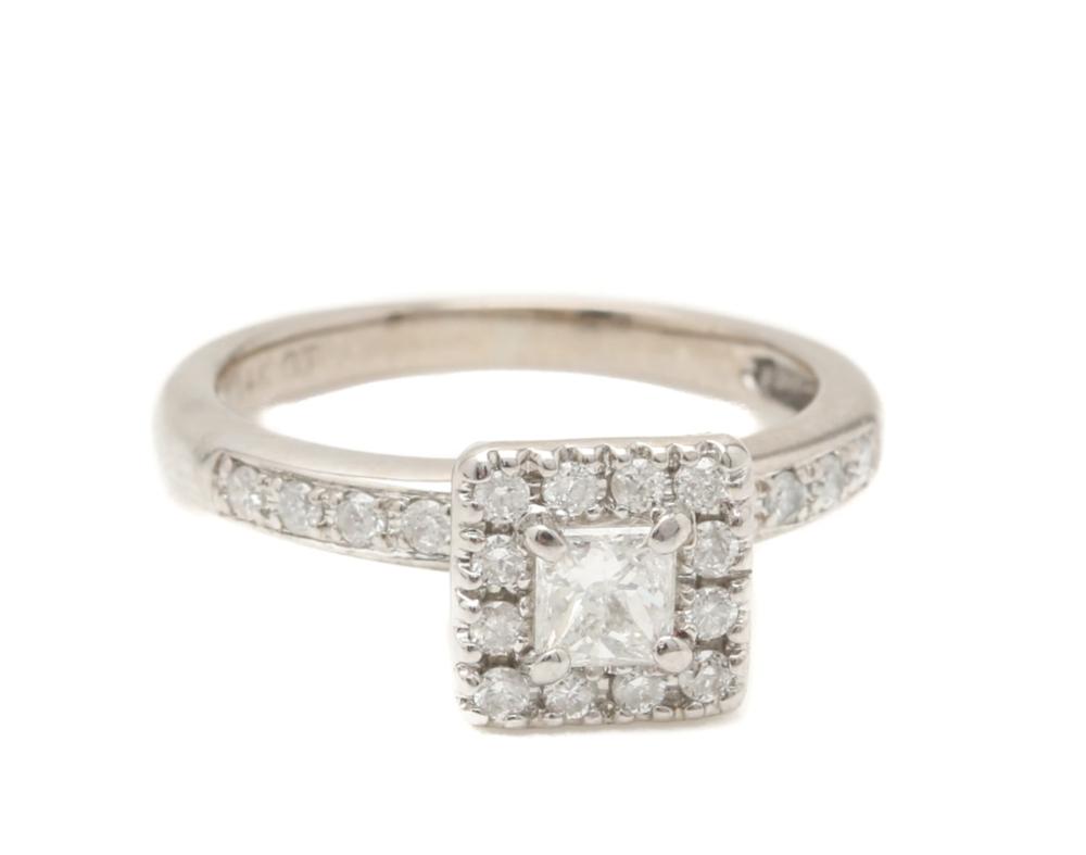 14k White Gold Diamond Ring. Current Bid Price: $70.
