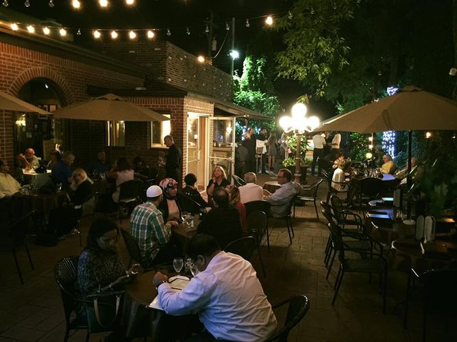 The warm glow of the patio at La Dolce Vita gives off the best warm weather vibes. Photo via  La Dolce Vita