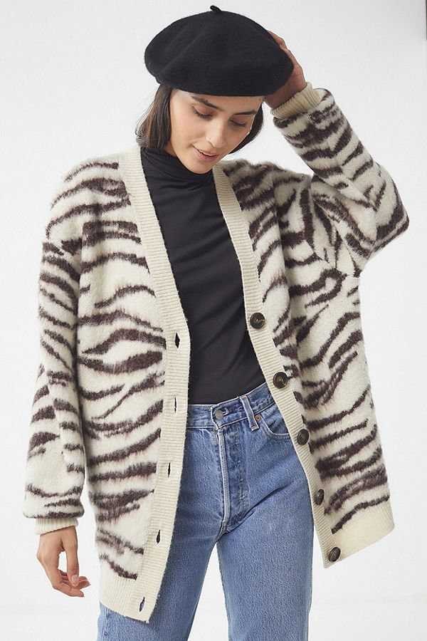 Animal print will be making its rounds this fall, and this  sweater from Urban Outfitters  is giving us the warm fuzzies.