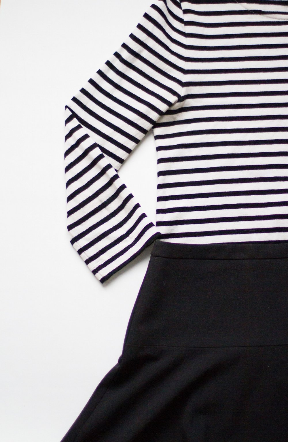 striped top / black skirt