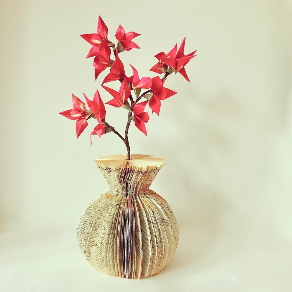 Branch in book vase