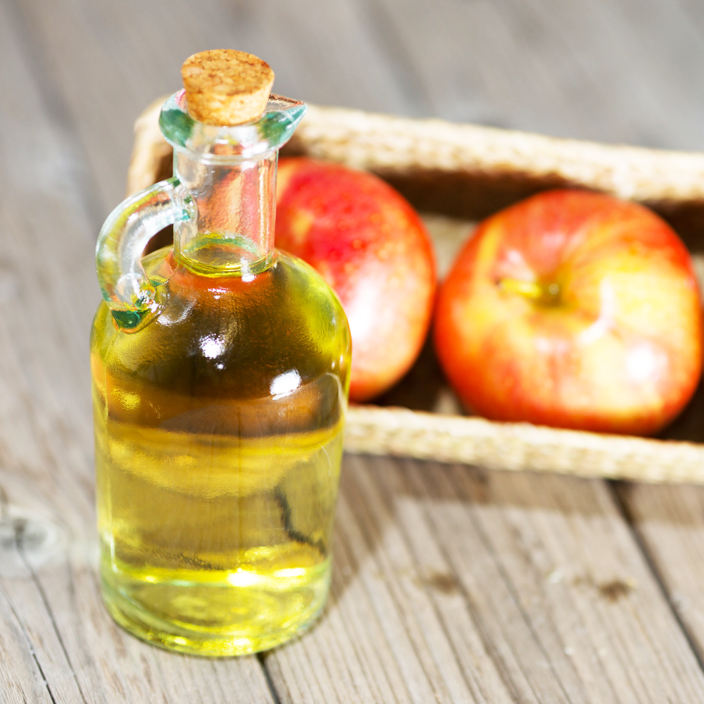 apple cider vinegar - The secret to successfully clearing your skin with apple cider vinegar (ACV) is to dilute! Pure apple cider vinegar is extremely acidic, so if applied directly to your face, it can throw your skin's balance out of wack. For the best results, dilute 1 part apple cider vinegar to 2 parts distilled/filtered water, then apply the diluted ACV directly to your pimples and blemishes using a cotton ball or clean wash cloth.The natural organic acids making up apple cider vinegar help balance the pH levels of your skin (remember, fighting acne is all about balance) and destroy acne-causing bacteria. Apple cider vinegar is rich in acetic acid, citric acid, lactic acid and succinic acid which have all been shown to fight a specific strain of acne-causing bacteria. Apple cider vinegar is also a natural astringent meaning it can be used as a facial toner (when diluted) to even out skin tone and reduce the appearance of large pores.